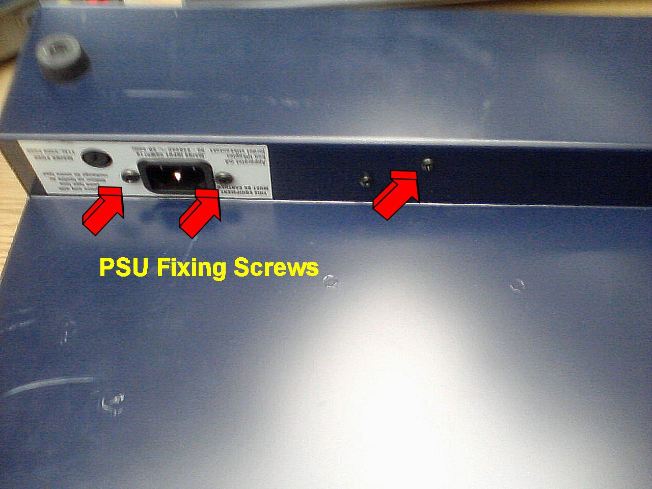Unscrew the IEC Socket Fixings and Board Retainer